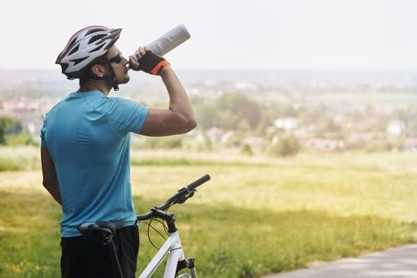 Cyclist Drinking Pickle Water